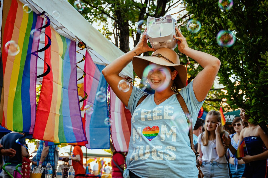 photo-of-a-smiling-woman-holding-device-on-head-2522707